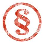 Roter Stempelabdruck eines Paragraphensymbols